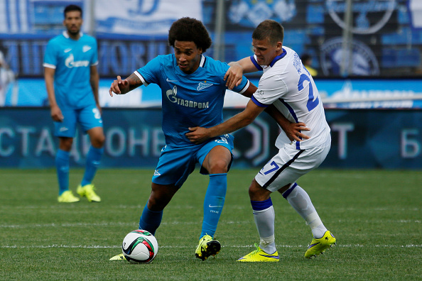 ST. PETERSBURG, RUSSIA - JULY 19: Axel Witsel (C) of FC Zenit St. Petersburg vies for the ball with Igor Denisov of FC Dinamo Moscow during the Russian Football League match between FC Zenit St. Petersburg and FC Dinamo Moscow at the Petrovsky stadium on July 19, 2015 in St. Petersburg, Russia. (Photo by Epsilon/Getty Images)